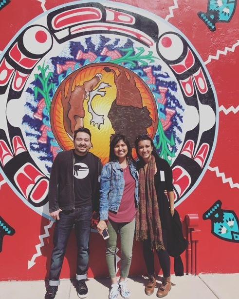 Rico Worl, Nanibaa, Raye Zaragoza in front of IAIA mural.